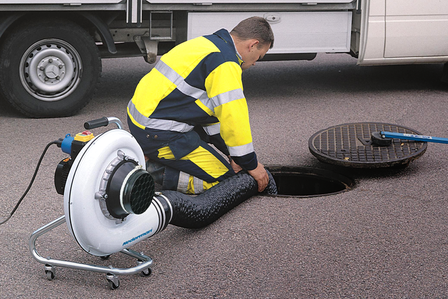 Nedermant fan used by sanitation worker